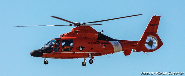 A USCG HH-65 Dolphin puts on a search and rescue demo.