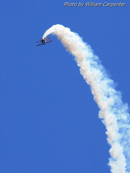 """Will Allen, """"The Flying Tenor"""", flys his aerobatic Pitts biplane. As usual, Will sang the national anthem while flying aerobatics to kick off the day's air show. This was my first time seeing Will flying the Pitts instead of his usual Super Decathlon."""