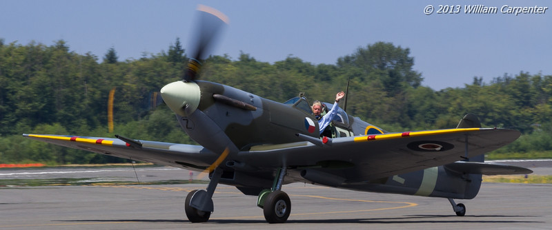 Bud Granley taxis by in the FHC's spitfire.