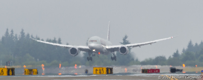 A Qatar Airways 787 lands as part of a test flight.