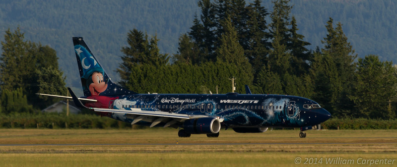 A Westjet 737 in a special Disney World livery arrives during the show.