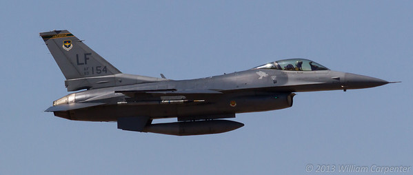 An F-16 takes off in preparation for a TAC demo featuring ground support from the Marines.