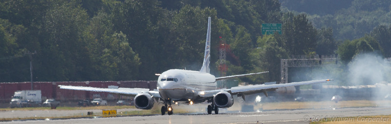 An Xtra Airways 737-400 arrives for what turned out to be a short stay at Boeing Field.