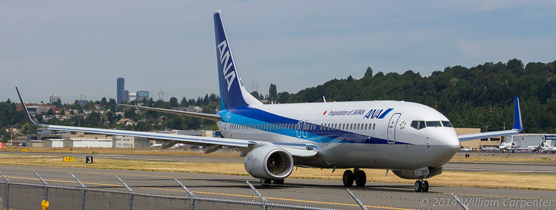 A 737 bound for All Nippon Airways taxis to the end of 31L before departing on a test flight.