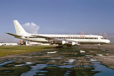Ghana Airways Airtours Douglas DC-8-33 N8184A (msn 45271) (Delta colors) MIA (Bruce Drum). Image: 104984.