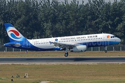 Chongqing Airlines Airbus A320-232 B-9977 (msn 5713) PEK (Michael B. Ing). Image: 913910.
