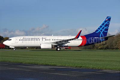 Sriwijaya Air Boeing 737-86Q WL N652AC (PK-CMF) (msn 32885) QLA (Antony J. Best). Image: 930129.