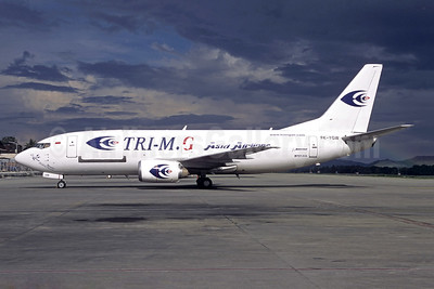 Tri-M.G. Asia Airlines Boeing 737-33A (F) PK-YGW (msn 27460) DJJ (Jacques Guillem Collection). Image: 945697.