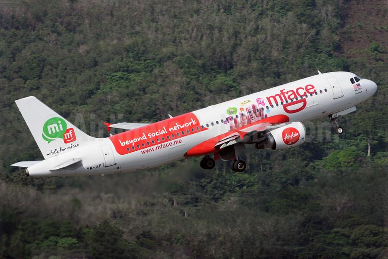 AirAsia (Malaysia) Airbus A320-216 9M-AFT (msn 3140) (mface - beyond social network) HKT (Richard Vandervord). Image: 924806.