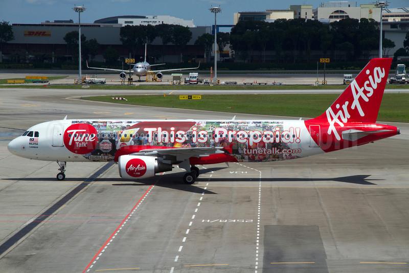 AirAsia (Malaysia) Airbus A320-216 9M-AHE (msn 3327) (Tune Talk - This is Prepaid!) SIN (Kok Chwee K.C. Sim). Image: 921088.