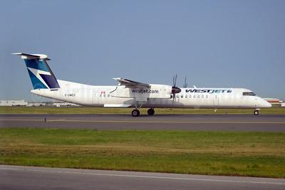 WestJet Encore Bombardier DHC-8-402 (Q400) C-GWEO (msn 4462) YYZ (TMK Photography). Image: 923871.