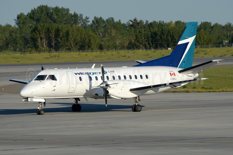 WestJet Link - Pacific Coastal Airlines SAAB 340A C-GPCJ (msn 006) YYC (Chris Sands). Image: 943491.