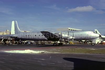 Com Tran St. Kiits - Commerical Transport (St. Kitts) Ltd. Douglas DC-7C (F) Seven Seas N16465 (msn 45120) MIA (Bruce Drum). Image: 105511.