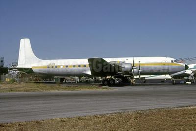 Com Tran St. Kiits - Commerical Transport (St. Kitts) Ltd. Douglas DC-7C (F) Seven Seas N16465 (msn 45120) MIA (Bruce Drum). Image: 105512.
