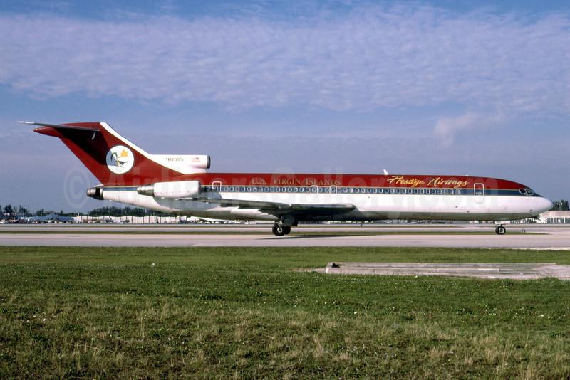 Prestige Airways (U.S. Virgin Islands) Boeing 727-231 N12305 (msn 19562) (UltrAir colors) MIA (Bruce Drum). Image: 102837.