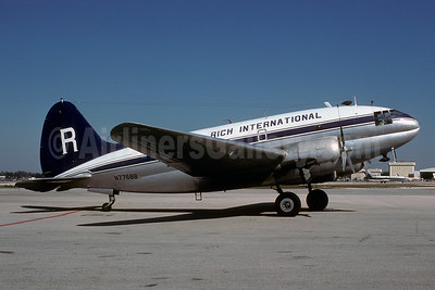 Rich International Airways Curtiss C-46A-60-CK Commando N7768B (msn 467) MIA (Bruce Drum). Image: 103133.