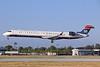 US Airways-Mesa Airlines (Mesa Air Group) Bombardier CRJ900 (CL-600-2D24) N902FJ (msn 15002) LGB (Michael B. Ing). Image: 920825.