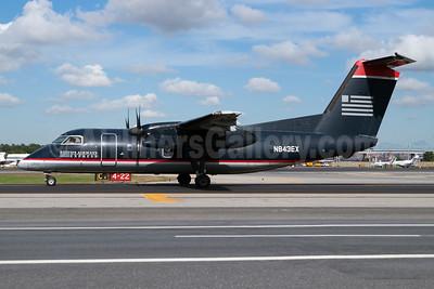 US Airways Express-Piedmont Airlines (2nd) Bombardier DHC-8-102 Dash 8 N843EX (msn 335) LGA (Fred Freketic). Image: 949971.