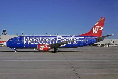 Western Pacific Airlines Boeing 737-3K9 N945WP (msn 24212) (blue fuselage side) ATL (Norbert G. Raith). Image: 921805.