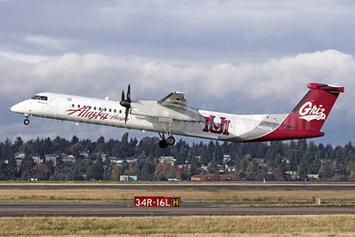 Alaska Horizon (Horizon Air) Bombardier DHC-8-402 (Q400) N402QX (msn 4032) (University of Montana-UM Griz) SEA (Michael B. Ing). Image: 927485.