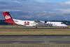 Alaska Horizon (Horizon Air) Bombardier DHC-8-402 (Q400) N402QX (msn 4032) (University of Montana-UM Griz) SEA (Michael B. Ing). Image: 927484.