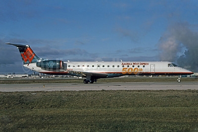 America West Express-Chautauqua Airlines Embraer ERJ 145LR N294SK (msn 145497) (500th Embraer Regional Jet) YYZ (TMK Photography). Image: 907715.