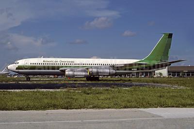 American Overseas Airways (2nd) Boeing 707-123B N519GA (msn 17646) (Transavia colors) MIA (Bruce Drum). Image: 103641.