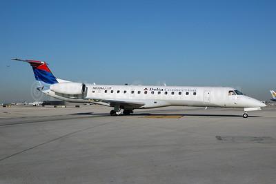Delta Connection-Freedom Airlines (2nd) Embraer ERJ 145LR (EMB-145LR) N830MJ (msn 145259) MIA (Bruce Drum). Image: 100400.