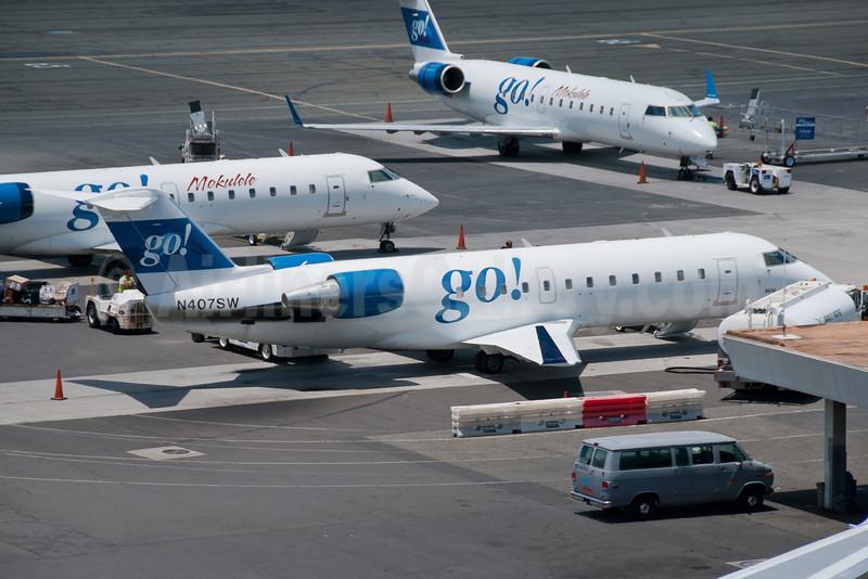 go! (iflygo.com) (Mesa Air Group) Bombardier CRJ100 (CL-600-2B19) N407SW (msn 7034) HNL (Ivan K. Nishimura). Image: 912670.