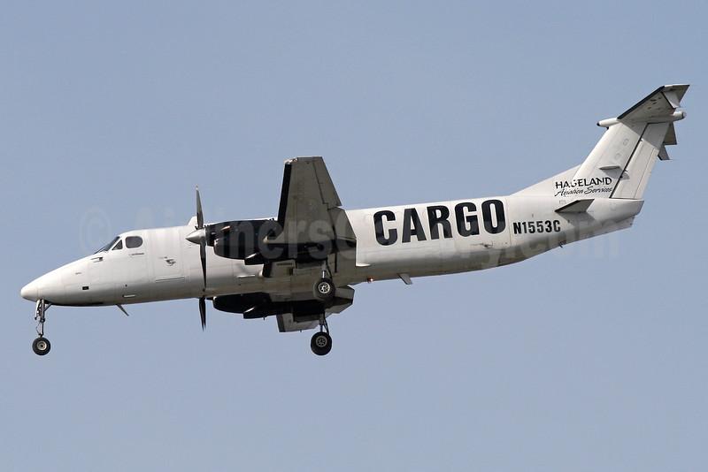 Hageland Aviation Services Cargo Beech 1900C-1 N1553C (msn UC-24) ANC (Brian McDonough). Image: 933827.