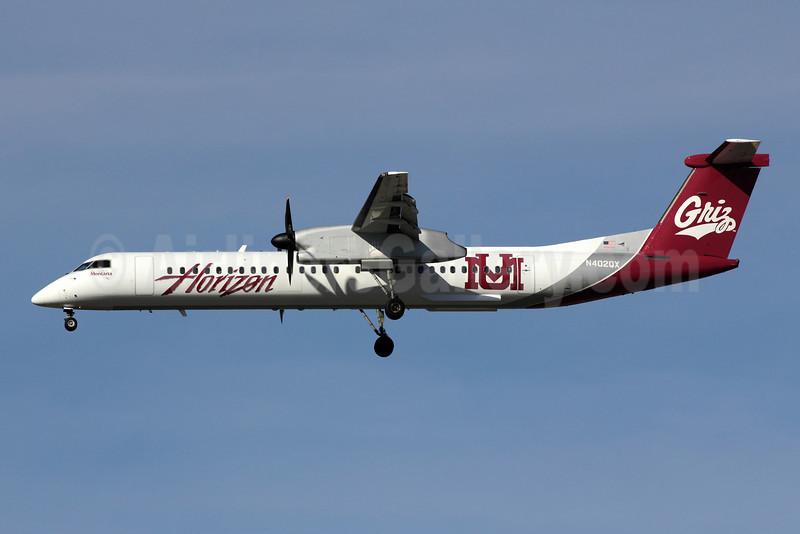 Horizon Air Bombardier DHC-8-402 (Q400) N402QX (msn 4032) (University of Montana-UM Griz) LAX (Michael B. Ing). Image: 909336.