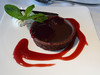 119 chocolate tart with raspberry sauce