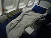 711 LH FRA-DEN first class cabin seat converted to bed