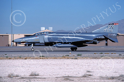 F-4USAF 00457 A taxing McDonnell Douglas F-4E Phantom II USAF 1075 3rd TFW PN code SHARKMOUTH Nellis AFB 10-1989 military airplane picture by David F Brown