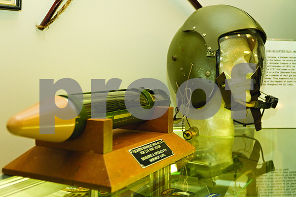Photo by Shannon Wilson / Tyler Morning Telegraph There are many interesting items in the collection at the Historic Aviation Memorial Museum, such as this flechette warhead and Vietnam helicopter pilot helmet.