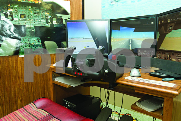 Photo by Shannon Wilson / Tyler Morning Telegraph A flight simulator is part of the experience at the Historic Aviation Memorial Museum.