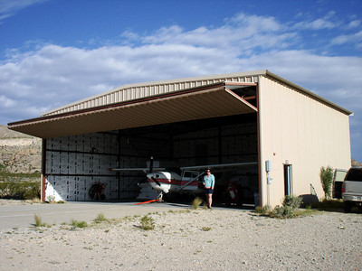 """""""FOUR PAPA SIERRA"""" AT HOME And here we are, me and my co-passenger, Natasha (well, that's her, anyway; I'm behind the camera), at Four Papa Sierra's hangar at Harte Ranch. Lots of room at this place!"""