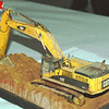 Cat excavator rebuilt diecast, one of the 1/50 scale diecasts torn apart, detailed and repainted, then weathered. Nice job.