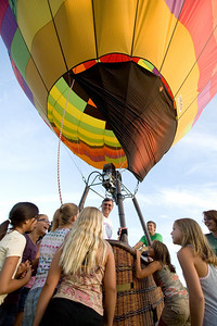 Rick Poe of the BUB Hot Air Balloon Team answers questions from curious bystanders after landing his hot air balloon near Bethany Road in Sycamore on the evening of Monday, August 12.