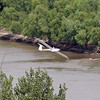 Bob Carlton's jet powered glider swooped down to the Missouri River before landing back at the airport.