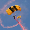 Two of the Army Golden Knights coming in with their smoke streaming.