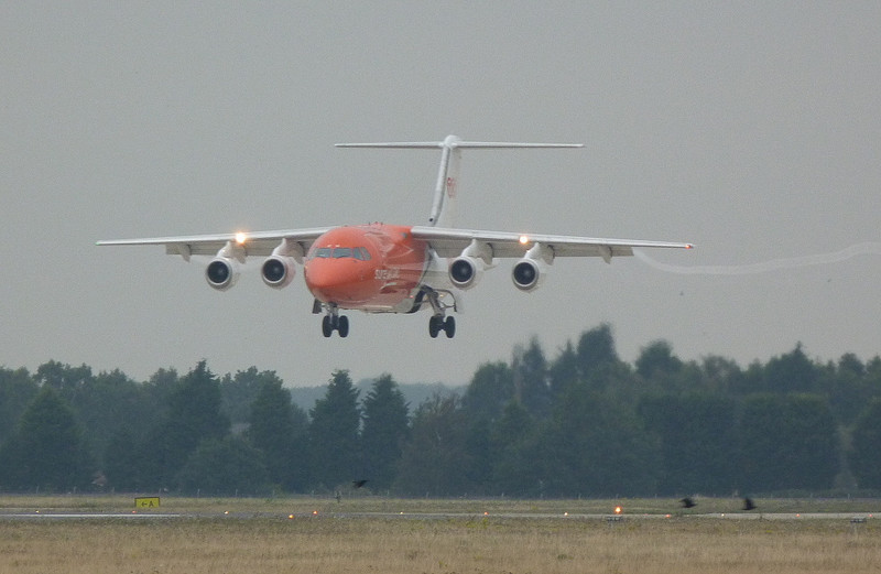 TNT BAe 146-300QT OO-TAF about to touch down on rnwy 20.<br /> By Clive Featherstone.