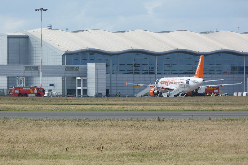 Easyjet A320 G-EZTA sits on the apron with fire tenders in attendance after diverting into DSA during a Manchester - Sofia flight. A320 G-EZTG arrived later to take the passengers forward to their destination.<br /> By Clive Featherstone.
