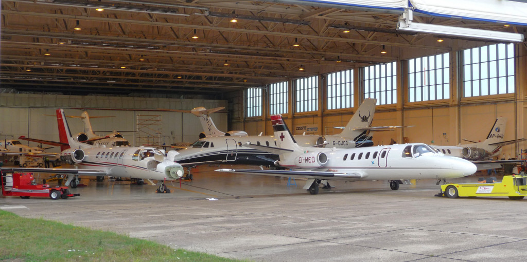 Busy Kinch hangar....on view are C550 G-JBLZ,  C550 EI-MED, C550 AP-BHD, C680 G-CJCC,<br />  C750 N750GF, B200 PH-ATM, C525 N646VP & C750 M-PRVT.<br /> By Jim Calow.