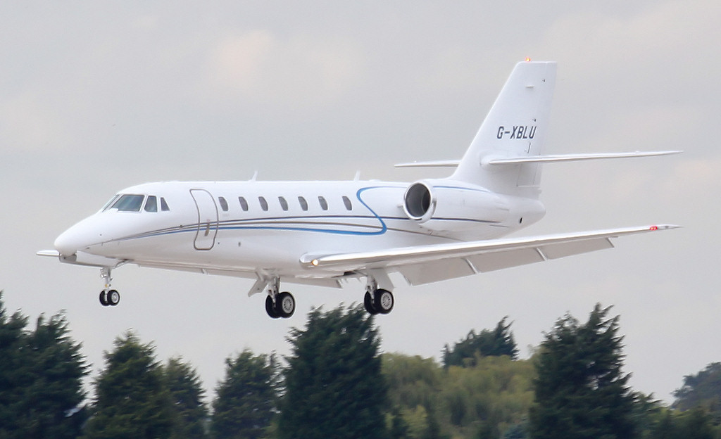 Cessna 680 Citation Sovereign, G-XBLU about to touch down on rnwy 20.<br /> By Jim Calow.