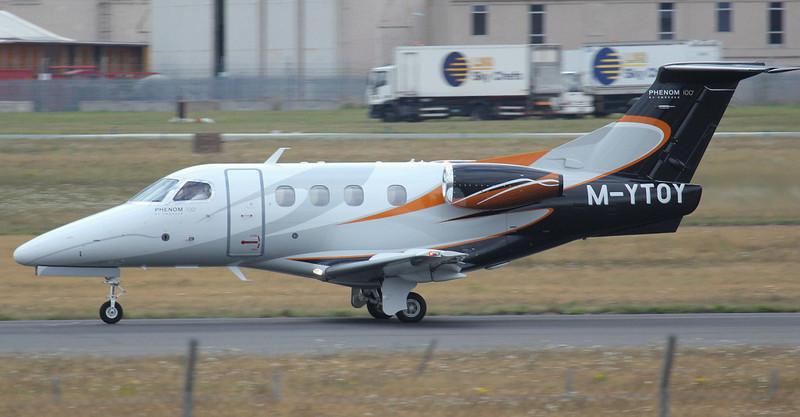 A few minutes later................Embraer EMB-500 Phenom 100  M-YTOY gathers speed.<br /> By Jim Calow.