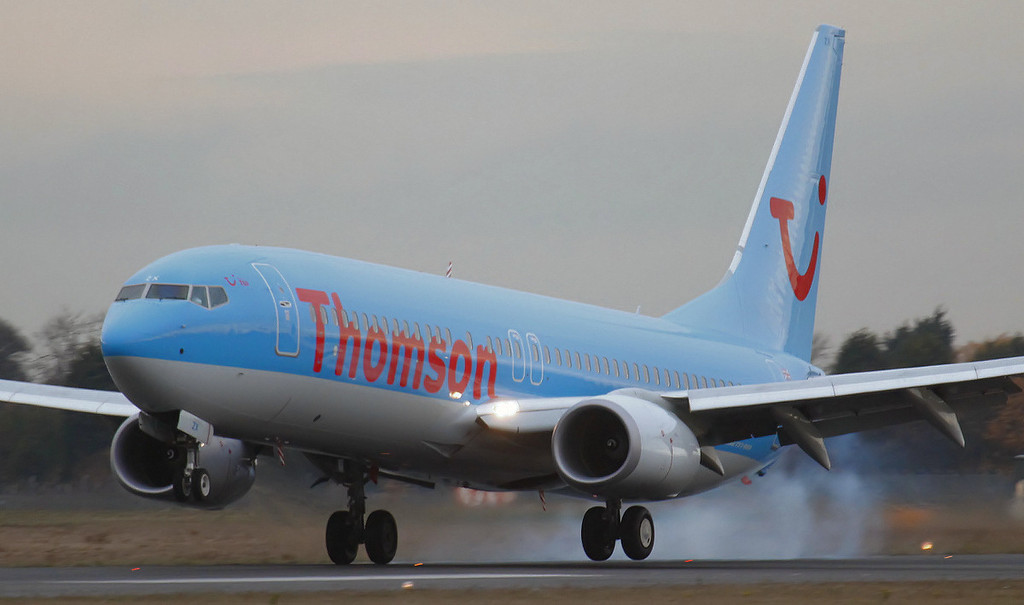 Thomson Airways 737-800 G-FDZX touches down on 20.<br /> By Jim Calow.