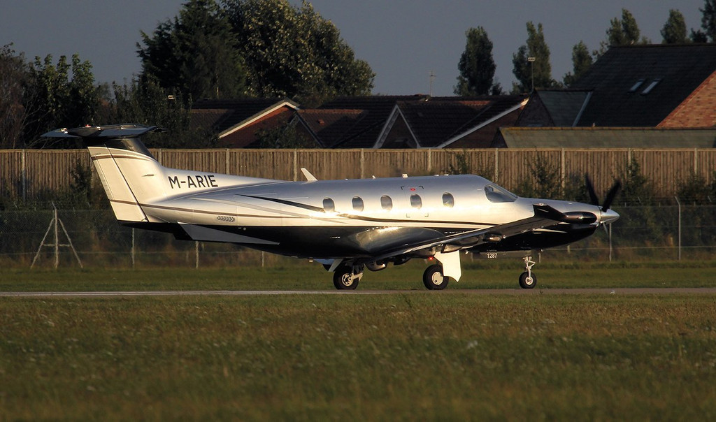 Pilatus PC-12/47E, M-ARIE, departs to Jersey.<br /> By Jim Calow.