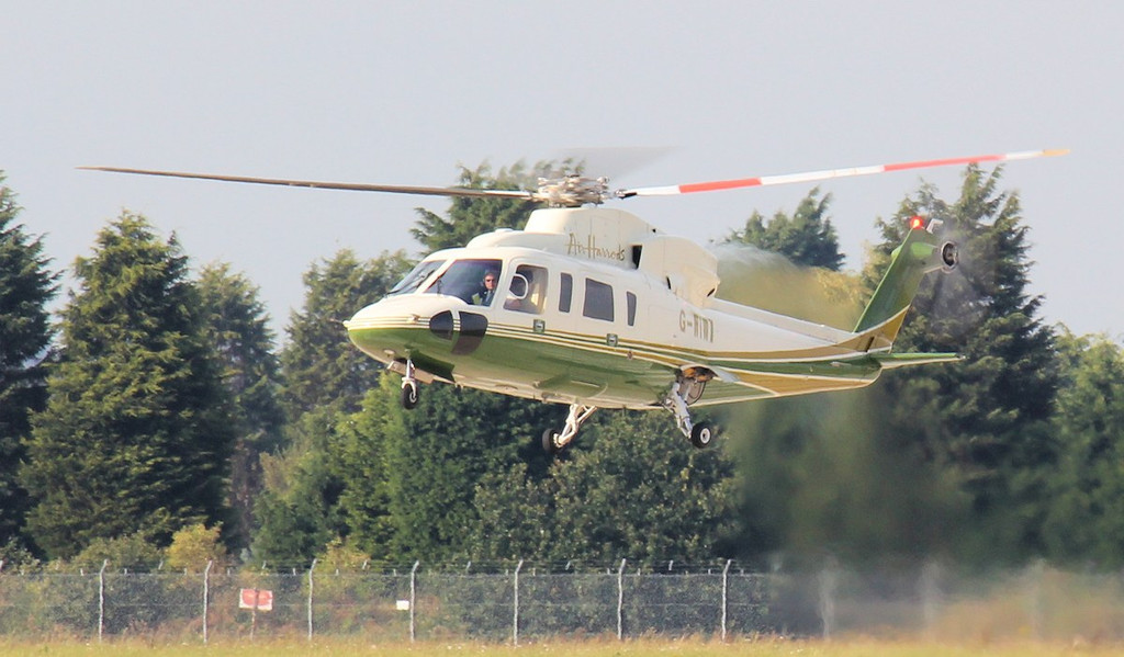 Air Harrods Sikorsky S-76C, G-WIWI, lifts off to depart to the racecourse.<br /> By Jim Calow.