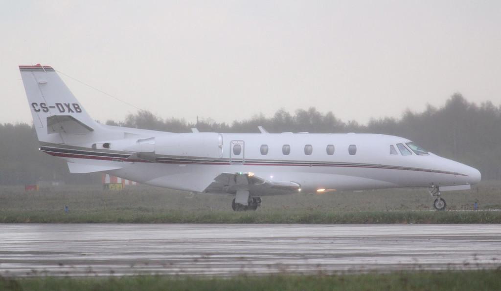 NetJets Europe Cessna 560XLS Citation XLS CS-DXB arrives in a downpour.<br /> By Jim Calow.